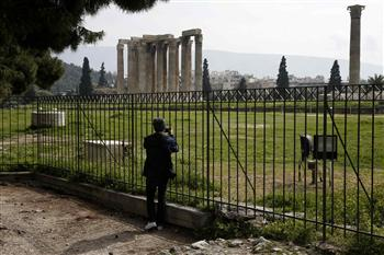 A tourist takes photographs of the temple of Zeus at the archaeological site of Olympeion in Athens March 8, 2013. REUTERS Photo