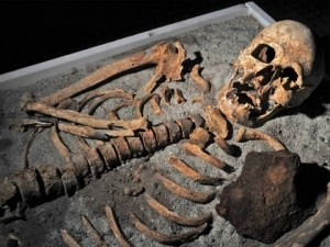 The skeleton of a man at Sozopol in Bulgaria, with an iron stake driven through his chest. Photo by Getty Images